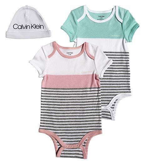 Új, címkés Calvin Klein márkás babaruha, kislány 3részes bodyszett.